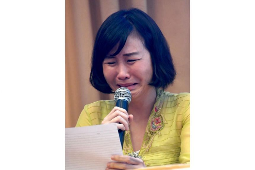 Veronica Tan, the wife of Jakarta Governor Basuki Tjahaja Purnama, known as Ahok, breaks down as she reads a handwritten letter from her husband during a press conference in Jakarta on May 23, 2017.