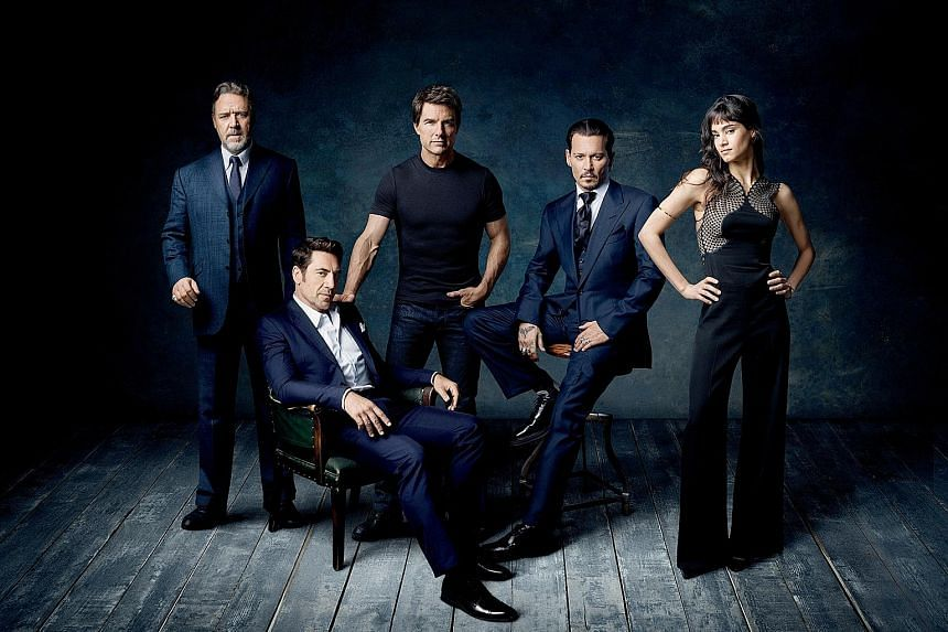 Stars of the upcoming Dark Universe films include (from left) Russell Crowe, Javier Bardem, Tom Cruise, Johnny Depp and Sofia Boutella.