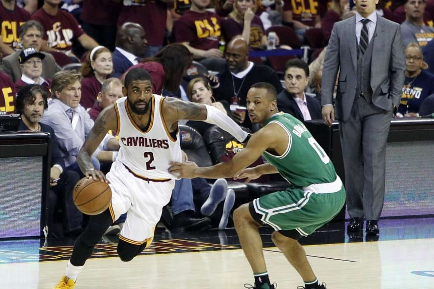 Cleveland Cavaliers guard Kyrie Irving (left) drives to the basket as Boston Celtics guard Avery Bradley (centre) defends during the second half of game three, on May 21, 2017.