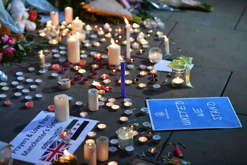 Messages and floral tributes are seen in Albert Square in Manchester, on May 23, 2017.