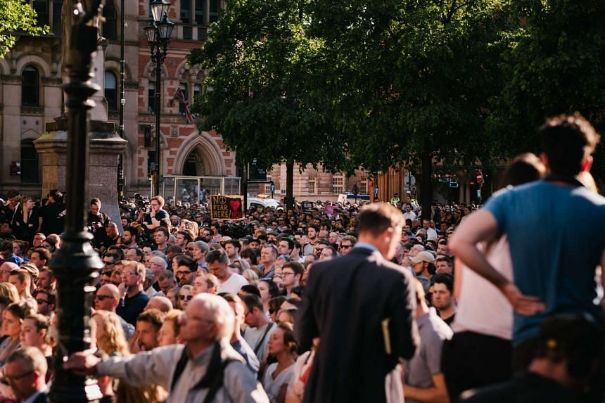 Mourners gathering at a vigil for the victims of the Manchester Arena bombing, at Albert Square in Manchester, on May 23, 2017.