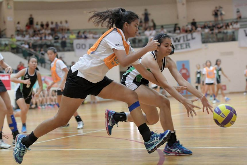 Schools National A Division girls final between RI (dark tank top) and ACJC at Toa Payoh Sports Hall.