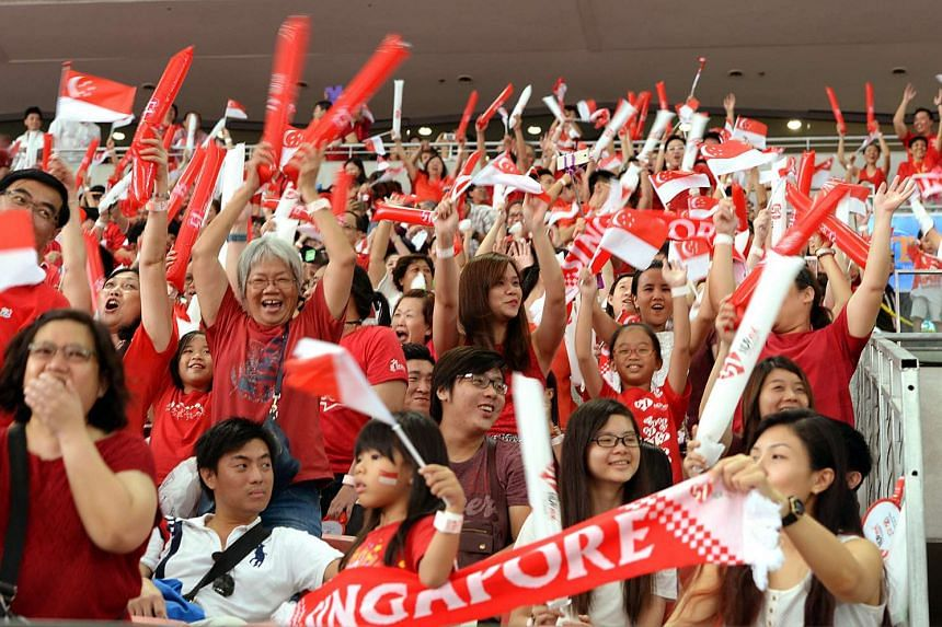 Parade-goers getting on their feet and roar as the Kallang Wave sweeps across the National Stadium at the National Day Parade 2016 (NDP 2016).