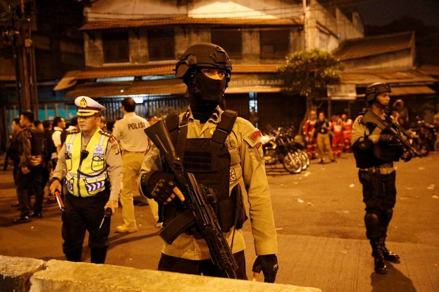 Police guard the site of two blasts in Jakarta, on May 24, 2017.