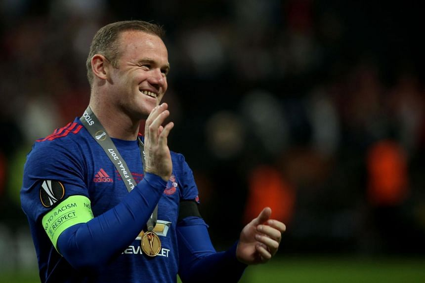 Manchester United's English striker Wayne Rooney celebrates after his team won the Uefa Europa League final football match against Ajax Amsterdam at the Friends Arena in Solna on May 24, 2017.