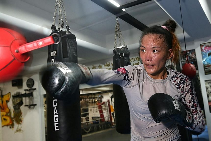 Singapore MMA fighter Tiffany Teo during Tuesday's training session at Juggernaut Fight Club's new gym on Syed Alwi Road. She will be looking to extend her perfect 5-0 career record when she takes on American Rebecca Heintzman- Rozewski tomorrow at O