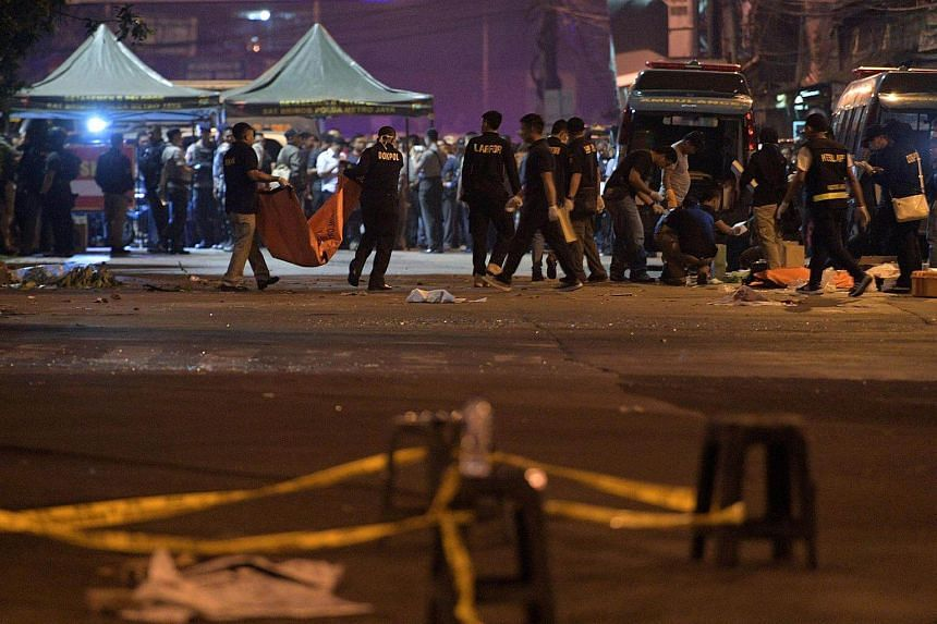 Police investigate the scene of an explosion at a bus station in Kampung Melayu, East Jakarta, Indonesia on May 25, 2017.