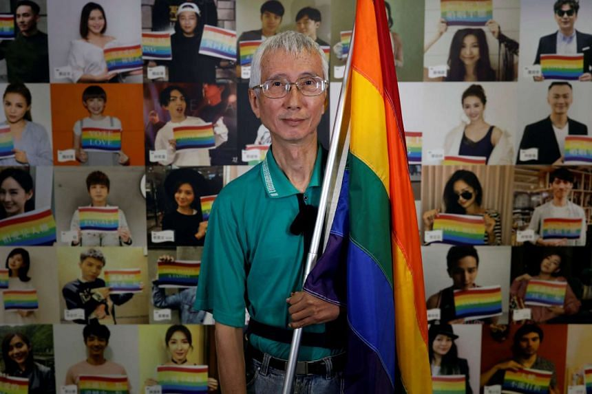 Chi Chia-wei, 59, a gay rights activist, one of the petitioners who has brought the case to the constitutional court, poses after an interview in Taipei.