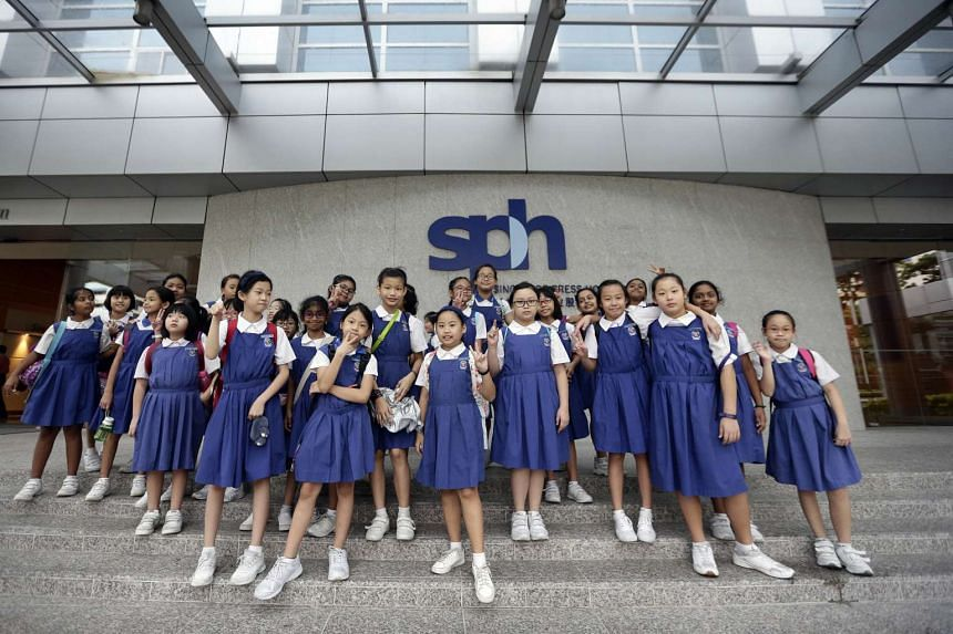 CHIJ Our Lady of the Nativity Primary 4 pupils taking a group photo outside the News Centre.