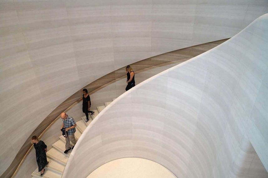 The curvy stone stairs leading up to the second level, which draws its design inspiration from Apple Park in Cupertino.
