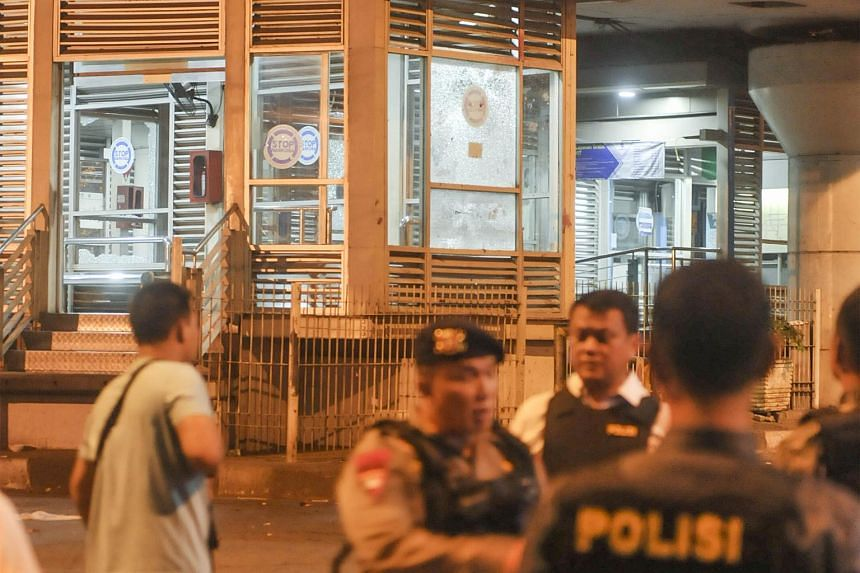 Indonesian police officers securing the area where two explosions occurred near Terminal Kampung Melayu in Jakarta, Indonesia, on May 24, 2017. At least two people, including a suspected suicide bomber, were killed.