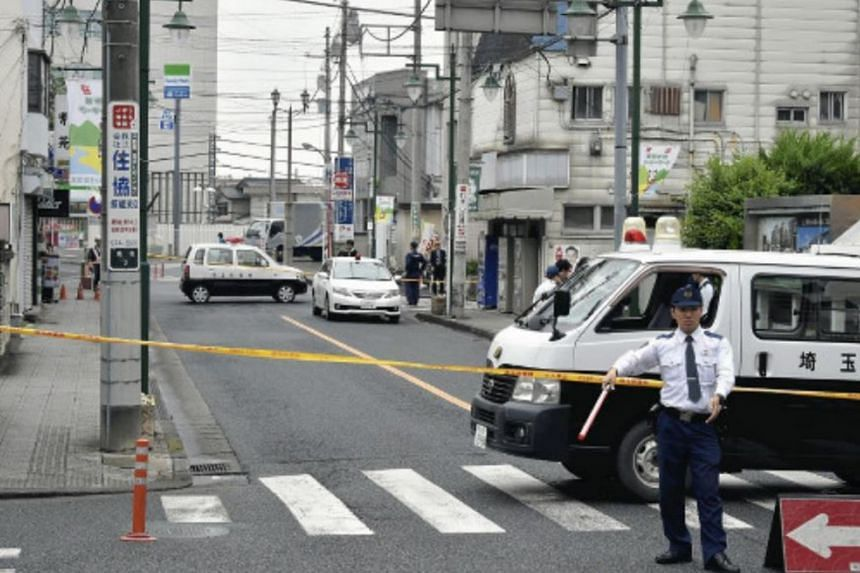 Police officers cordoning off the area, after a suspected bomb threat, near Higashi-Hanno station in Saitama prefecture, on May 25, 2017.