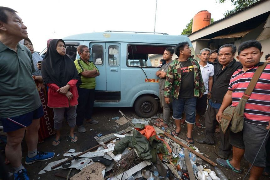 Indonesian people gathered at the scene where two bombers launched an attack, in Jakarta, on May 25, 2017.