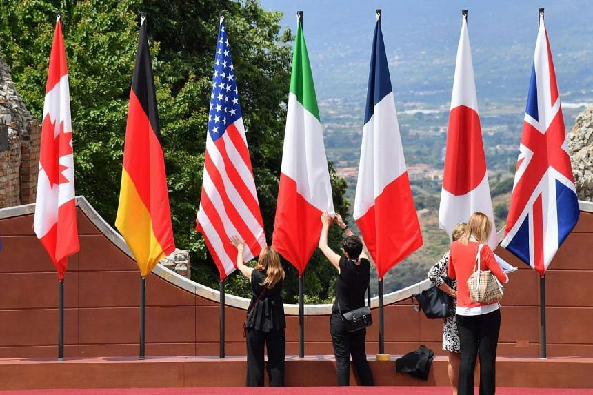 The flags of the G-7 countries are prepared at the ancient theatre of Taormina, the venue of the annual summit.