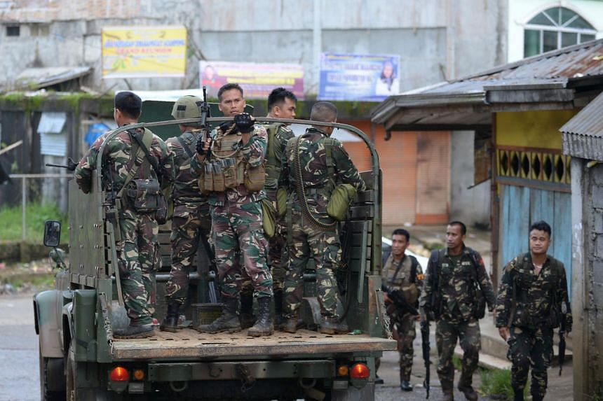 Philippine soldiers conduct a patrol in Marawi on the southern island of Mindanao on May 26, 2017.
