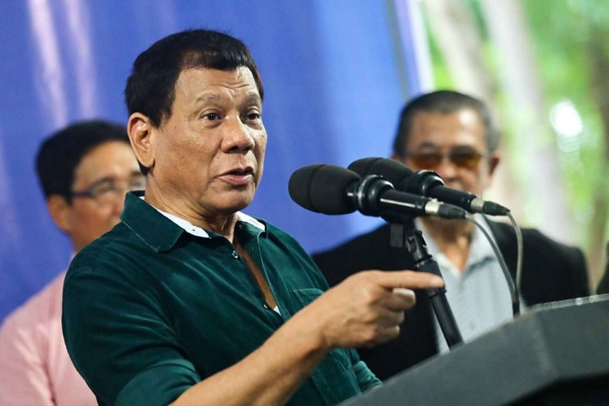 Filipino President Rodrigo Duterte (centre) speaking during a visit to troops, in Iligan city, Mindanao island, southern Philippines, on May 26, 2017.