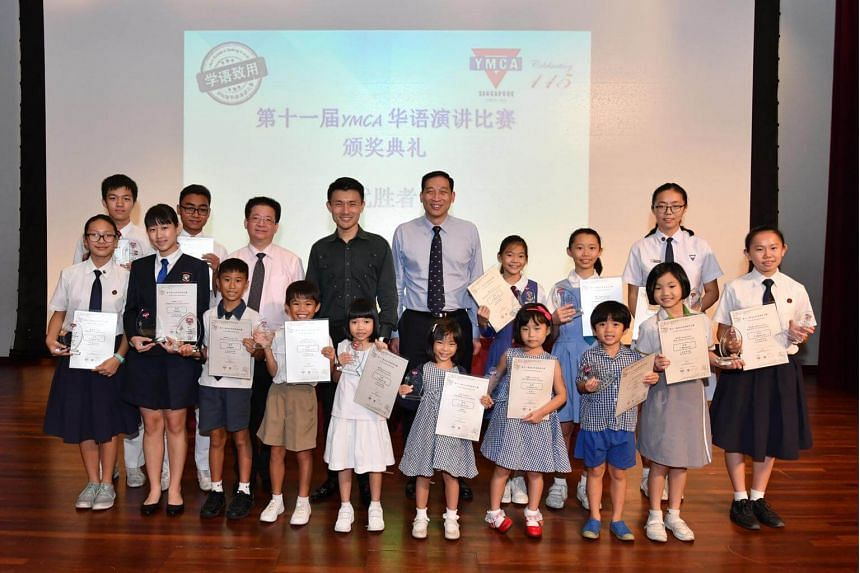 Award recipients at the 11th YMCA Mandarin Speaking Awards, which aims to hone students' Mandarin speaking skills and develop confidence in youth.