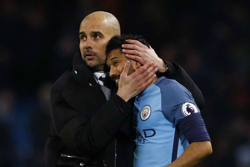 Manchester City manager Pep Guardiola with Gael Clichy after a match against Stoke City.