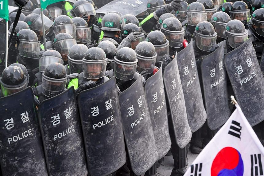 Supporters of ousted president Park Geun-Hye clash with police in March. Police tactics in South Korea have often drawn criticism for being harsh and overly aggressive.