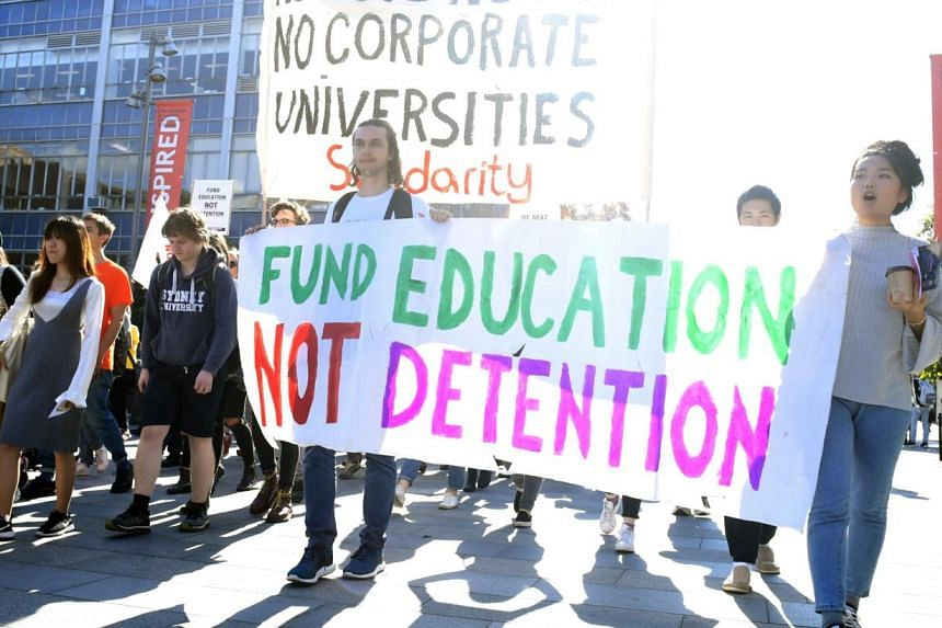 Students protest against a federal plan to cut funding for higher education. The collapse of Careers Australia comes as the government reviews the way funding is distributed to the sector.