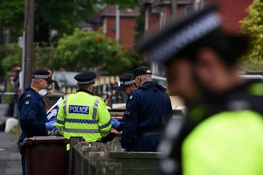 Police officers arrive at a residential property on Elsmore Road in Fallowfield, Manchester, on May 24, 2017.