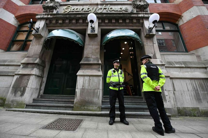 Police officers stand on duty outside Granby House in Manchester on May 24, 2017.
