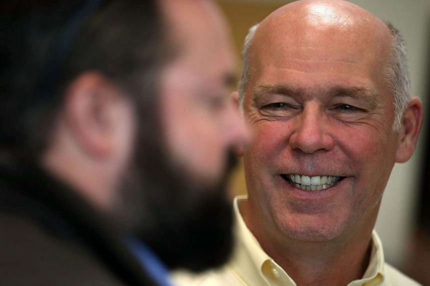 Gianforte talks with a supporter during a campaign meet and greet in Montana.