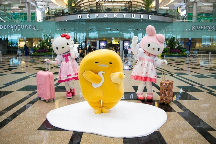 Mascots Hello Kitty, Gudetama and My Melody from the Sanrio franchise posing during a showcase at Changi Airport Terminal 3 on May 26, 2017.