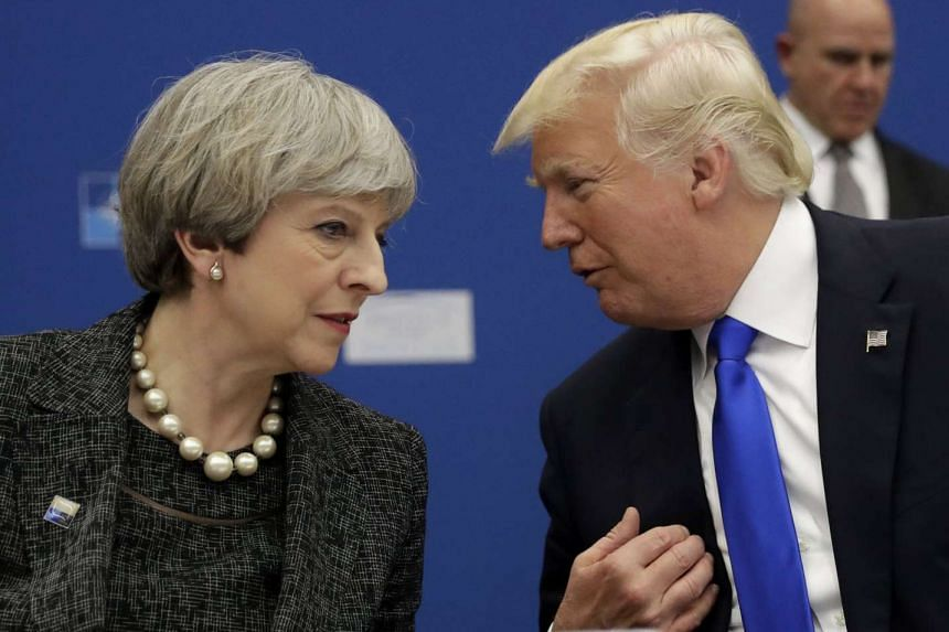 Trump and British PM May during a working dinner at the Nato summit in Brussels.