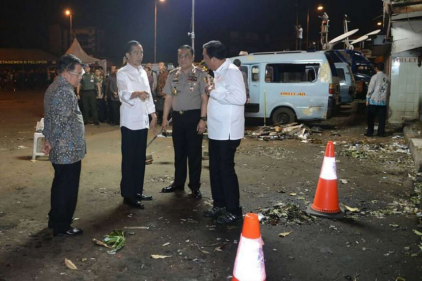 President Joko Widodo (second from left) and Vice-President Jusuf Kalla (right) visit the site of the suicide bombing near a Jakarta bus station.
