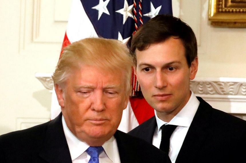 US President Donald Trump and his senior advisor Jared Kushner arrive for a meeting with manufacturing CEOs at the White House in February.