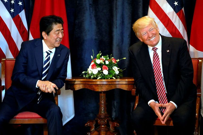 Trump and Abe smile during a bilateral meeting at the G-7 summit.