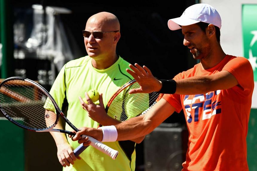 Djokovic (right) and coach Andre Agassi at a training session ahead of the French Open, May 26, 2017.