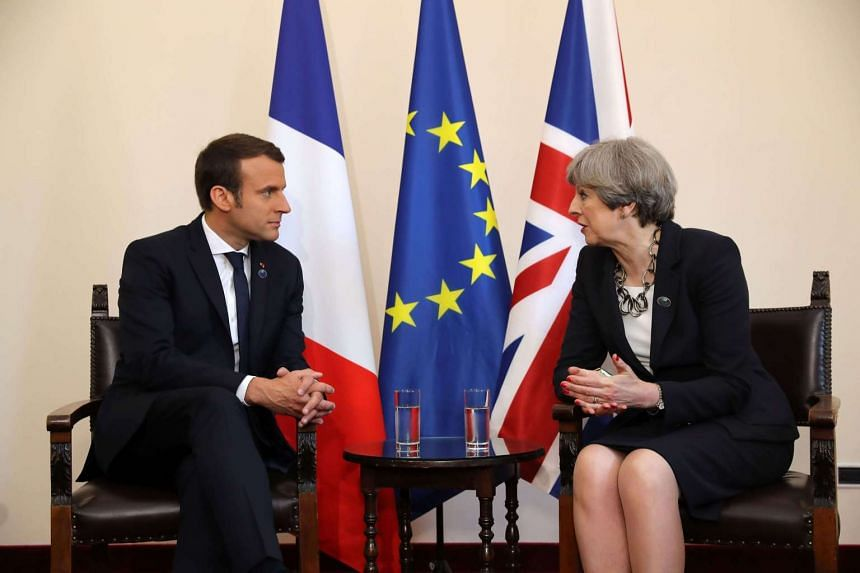 Britain's Prime Minister Theresa May and French President Emmanuel Macron talk during a bilateral meeting on May 26, 2017 in Taormina, Sicily.