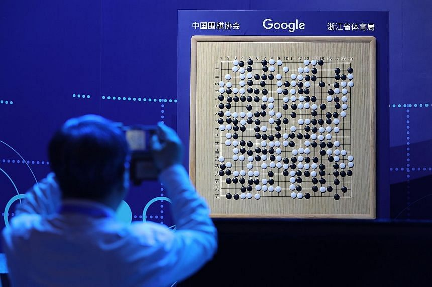 A board shows Tuesday's match between Chinese Go master Ke Jie and AlphaGo, during the Future of Go Summit in Wuzhen, China. AlphaGo's triumph in China offers a marketing boost for Google.