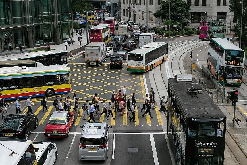 """The central business district in Hong Kong. Citing the city's """"close and tightening"""" links with China, Moody's cut Hong Kong's credit rating this week, in a move at odds with local economic health."""