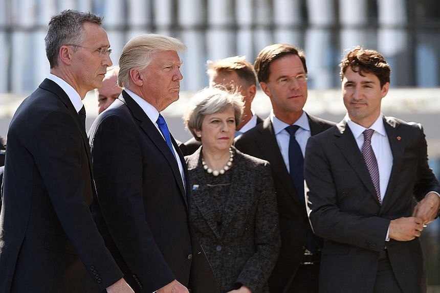 Key Western leaders - (from left) Nato Secretary-General Jens Stoltenberg, US President Donald Trump, Britain's Prime Minister Theresa May, Dutch Prime Minister Mark Rutte and Canadian Prime Minister Justin Trudeau - gathering yesterday for the unvei