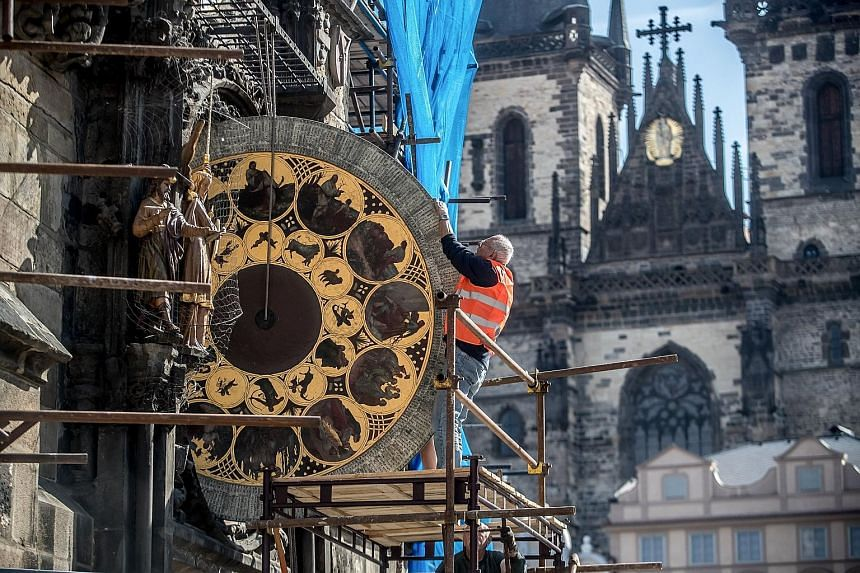 The calendar clock from Prague's Old Town astronomical clock was dismantled by clockmaker Petr Skala yesterday, during the ongoing renovation of the Old Town Hall tower at the Old Town Square in the Czech Republic's capital. The astronomical clock wi