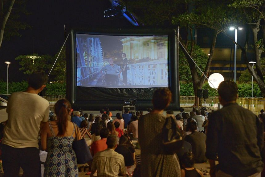About 200 people enjoying the free screenings of local films 7 Letters and Eating Air in the carpark area of the F1 pit building during the Singapore Coffee Festival on June 11, 2016.