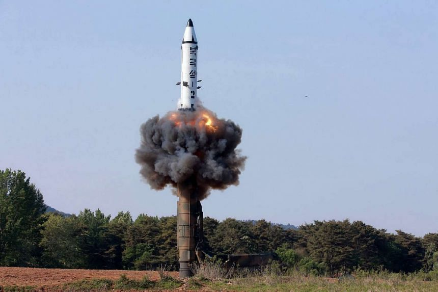 This undated photo shows North Korean ground-to-ground medium-to-long range strategic ballistic missile Pukguksong-2 being launched in a test-fire.