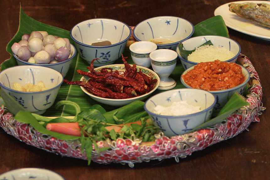 Ingredients for nasi ulam include herbs such as turmeric leaves, kaffir lime leaves and torch ginger flower.