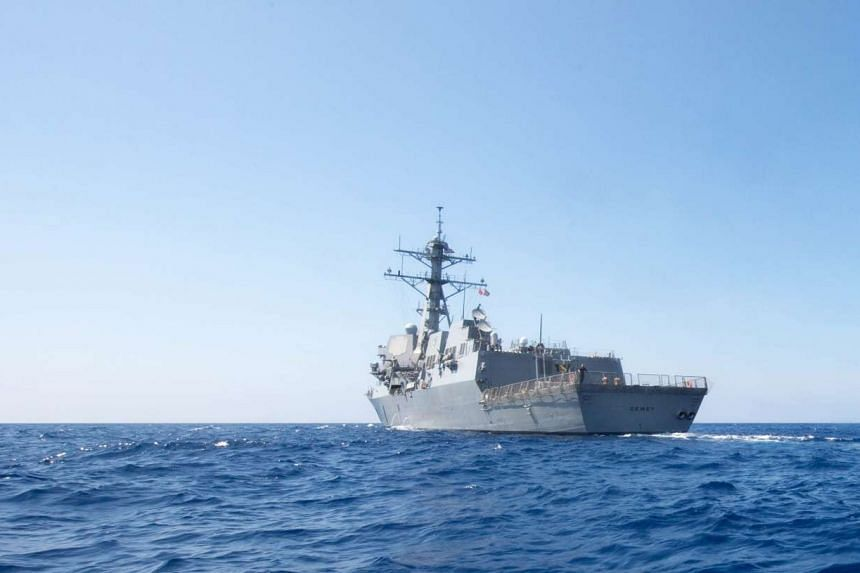 Arleigh Burke-class guided-missile destroyer USS Dewey (DDG 105) transits the South China Sea.