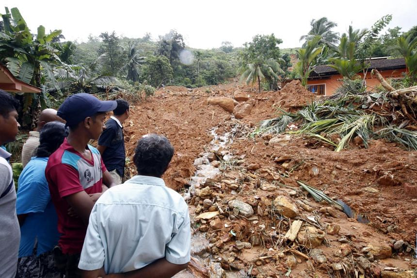 A landslide which completely buried four houses and killed 10 people at Bellana in Agalawatte, 84 kms from Colombo, Sri Lanka on May 27, 2017.