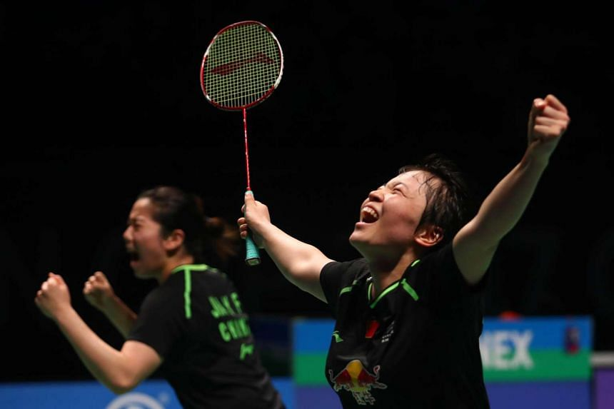 Chen Qingchen (right) and Jia Yifan (light) of China celebrate their victory in the women's doubles Sudirman Cup match against Misaki Matsutomo and Ayaka Takahashi of Japan at the Gold Coast Sports Centre on May 27, 2017.