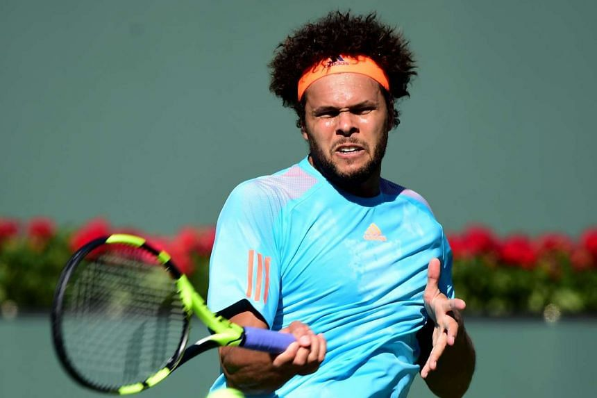 Tsonga (above, in a file photo) served 14 aces to reach the 26th final of his career.