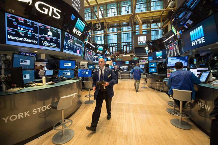 Traders on the floor of the New York Stock Exchange. The markets appeared to be taking a breather after six days of steady gains.