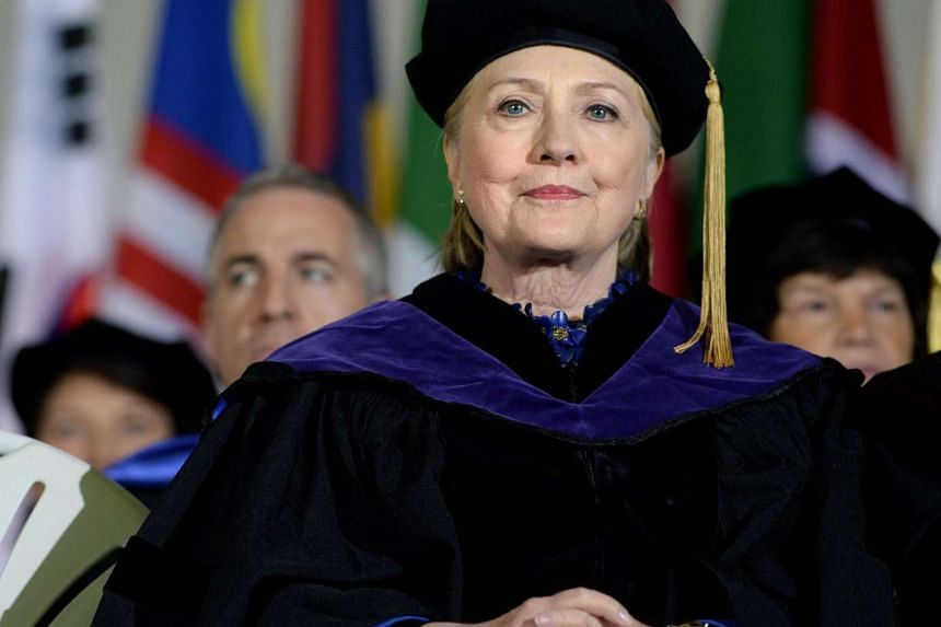 Hillary Clinton listens during commencement at Wellesley College, May 26, 2017.