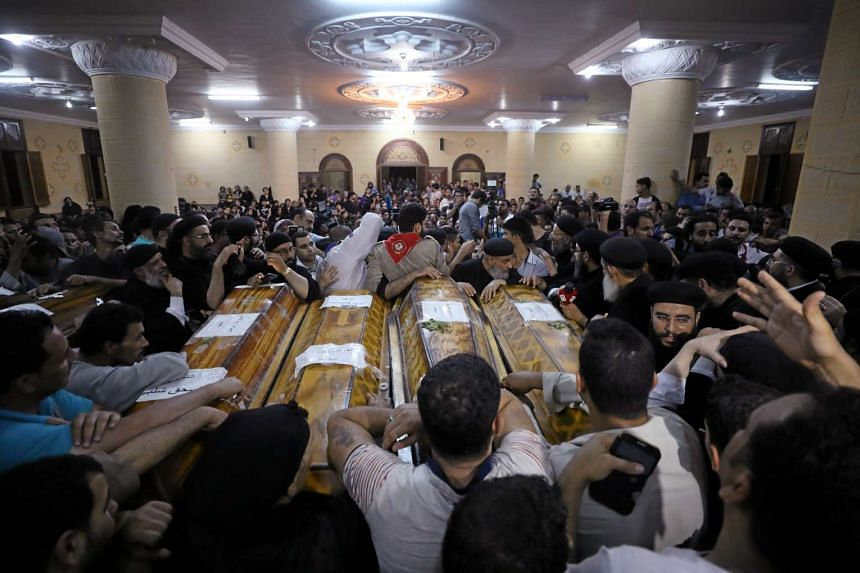 Mourners gathering at the Sacred Family Church for the funeral of Coptic Christians who were killed in Minya, Egypt, on May 26, 2017.