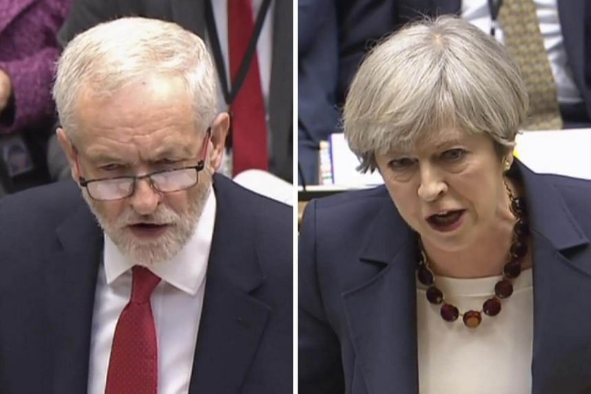 British Prime Minister Theresa May (right) and main opposition Labour Party leader Jeremy Corbyn (left) during the weekly Prime Ministers Questions session in the House of Commons in London on April 26, 2017.
