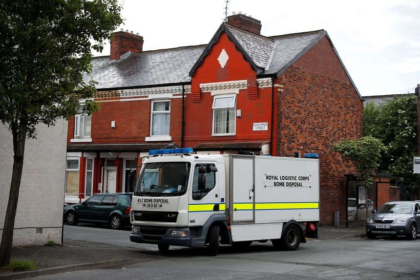 A bomb disposal unit stops outside a street in Moss Side, Manchester, Britain on May 27, 2017.